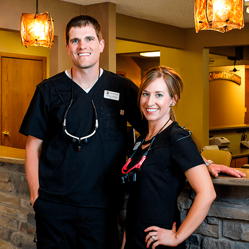 Dentist Mitchell SD - Our dentists smiling and welcoming you to their practice