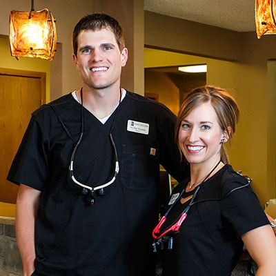 Our dentists, Drs. Eric and Jennifer Veurink, smiling and welcoming you to their practice who also offer the Invisalign