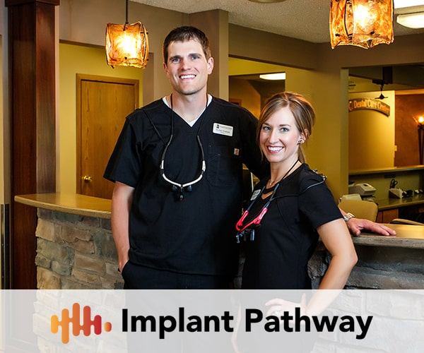 Dentists in Mitchell and Kimball, SD, Eric and Jennifer Veurink with the Implant Pathway logo