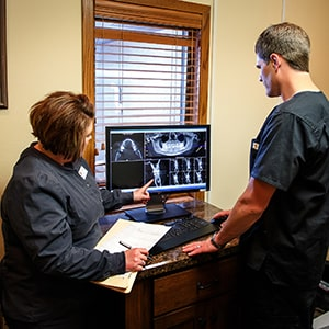 Dentist in Mitchell, SC, Dr. Eric Veurink looking at a potential dental implant case